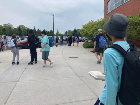 Students of all grades eagerly head out to the parking lot for lunch.